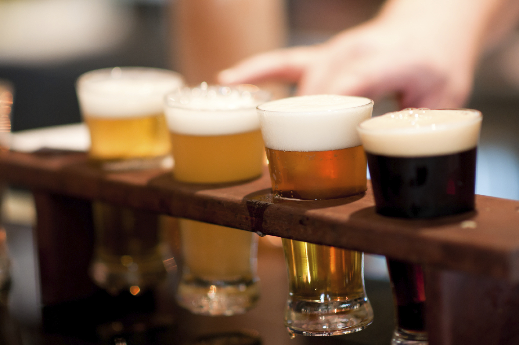 Research shows a compound in beer may save your brain from disease as you age.
