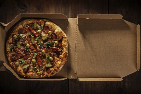 Pizza delivery boxes contain toxic chemicals that have been banned by the FDA.