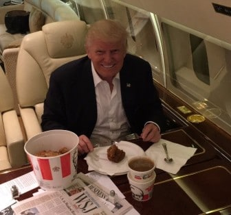 Trump aboard his jet with a bucket of KFC