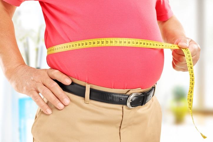 Overweight Male measuring bellyfat