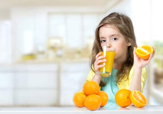 Girl Child Drinking OJ