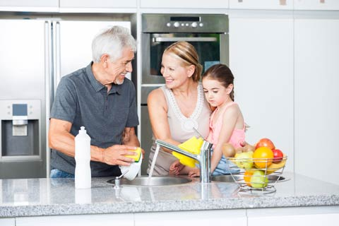 Grandparents and washing dishes with Granddaughter