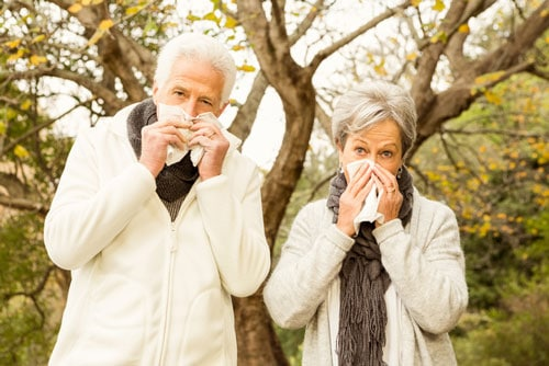 Couple Blowing Nose