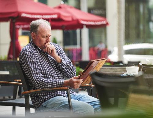 Man Reading Germy Menu