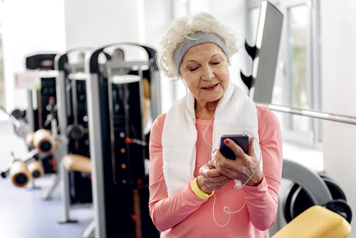 Lady Listening to music at gym