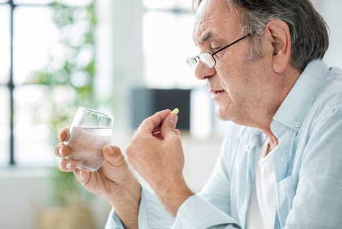 Man Taking Aspirin