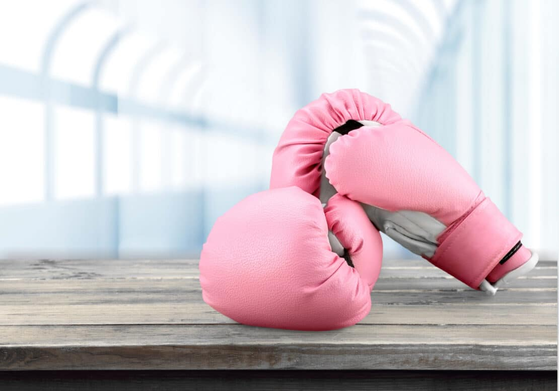 Picture of pink boxing gloves. Symbolic to beating breast cancer.