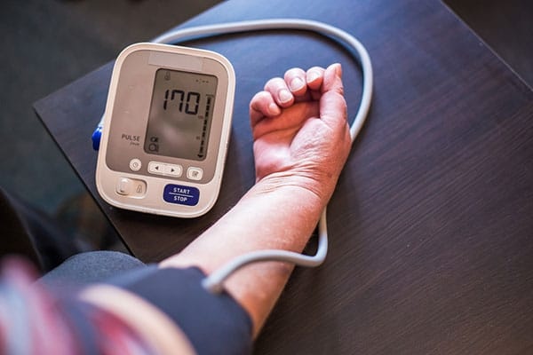 Photo of person taking blood pressure.