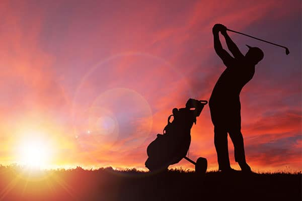 Photo of person playing golf.
