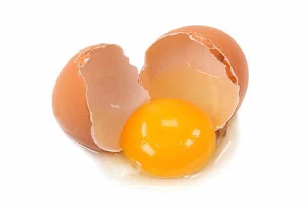 Photo of egg cracked open.