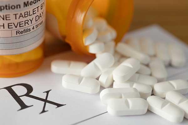 Photo of RX prescription and pills.