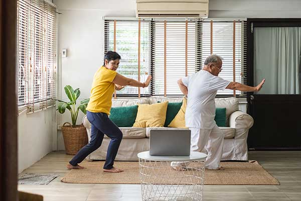 Photo of two people practicing Tai Chi
