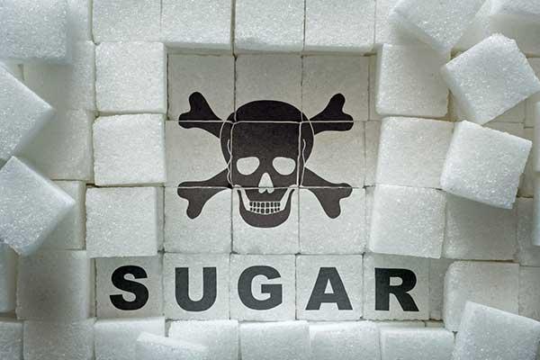 Death symbol with the word sugar underneath.